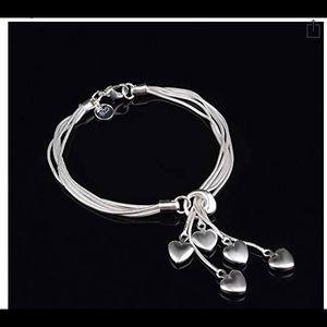 Sterling silver five string bracelet